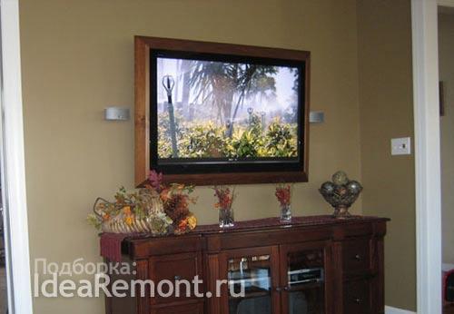 Идея для гостиной в классическом стиле: телевизор в раме